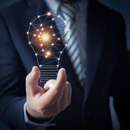 business-man-holding-bright-light-bulb-hand_28629-1091